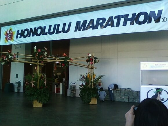 How to reduce the cost to go honolulu marathon title